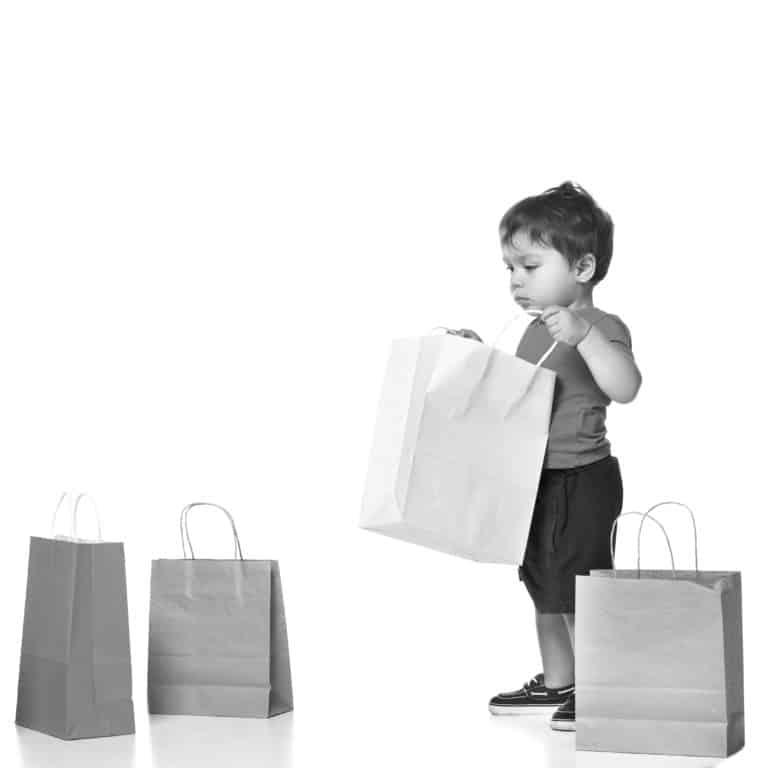 boy holding shopping bag isolated on white .