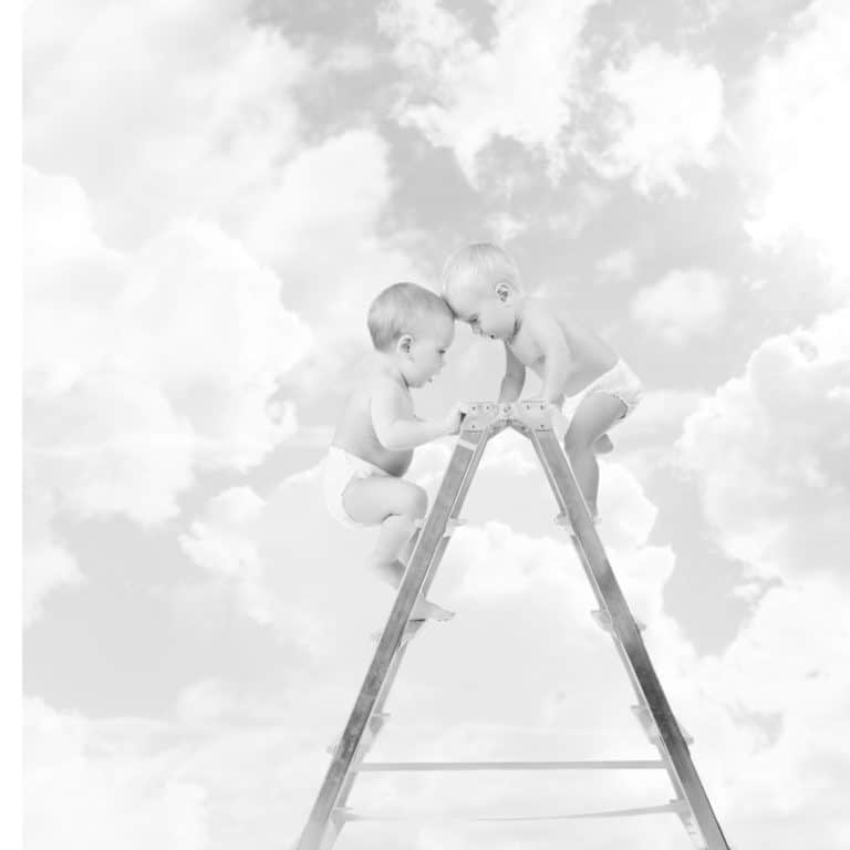 20206356 - baby climbing on stepladder and fighting  for first place over sky background  competition concept